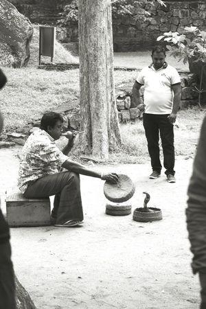 Snake charmer or belly full? Streetphotography Snake Charmer ThePhotojournalist2016eyeEmAwards SriLanka People Photography Street Life The Street Photographer - 2017 EyeEm Awards The Photojournalist - 2017 EyeEm Awards