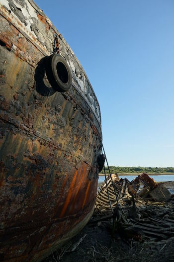 Abandoned boat against clear sky