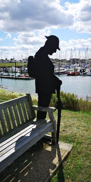 lest we forget Poinant Sillouette Remembrance Water Nautical Vessel Harbor Full Length Sitting River Sky Cloud - Sky Bench Park Bench Empty Park Boat