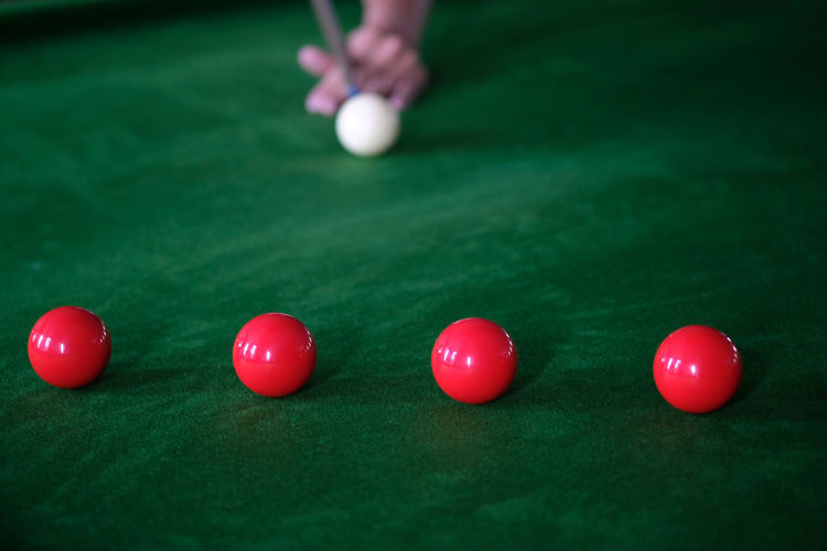 Close-up of person playing snooker