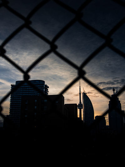 Architecture Built Structure Chainlink Fence City Cityscape Day Modern No People Outdoors Silhouette Sky Skyscraper