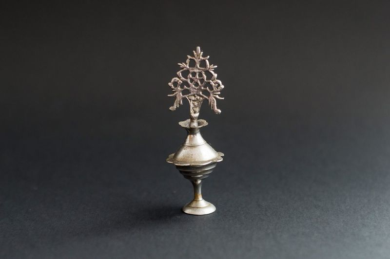 Close-up of electric lamp on table against black background