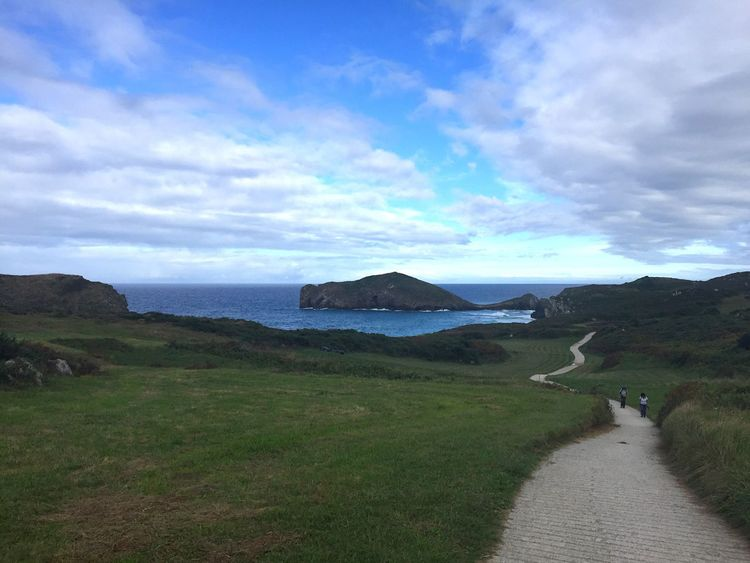 Sea Horizon Over Water Water Tranquil Scene Tranquility Grass Scenics Road Sky Cloud - Sky The Way Forward Beauty In Nature Nature Tourism Iphone6 Asturias Paraiso Natural🌿🌼🌊🌞 Stone - Object Travel Destinations Llanes Blue Paradise Mountain Vacations