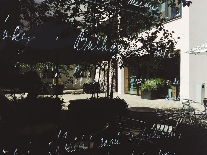 Reflection Sign Architecture Building Exterior Cafe Chair Day No People Outdoors Restaurantt Table Tree