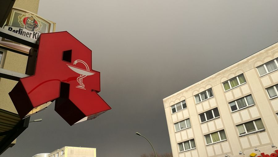 No People City Outdoors Day Before The Storm Dramatic Sky Red Sign Pharmacy Signage House Facade Berliner Kindl Adapted To The City Minimalist Architecture The Street Photographer - 2017 EyeEm Awards BYOPaper!