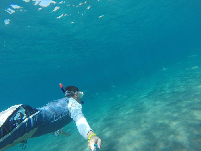 Portrait of man swimming undersea