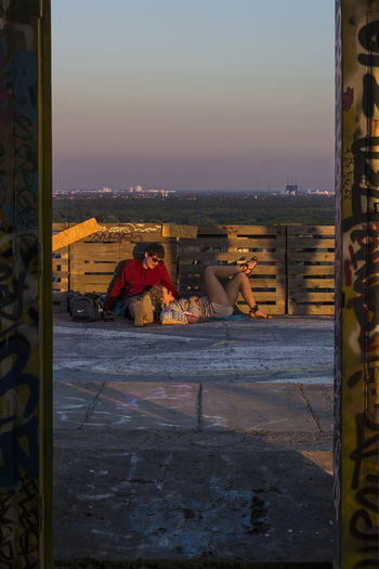 Love at Devil's Mountain. FILIPPI GIULIA PHOTOGRAPHY. Abandoned Abandoned Places Architecture Berlin Building Building Exterior Canon Cityscape Germany Graffiti Horizon Lanscape Light And Shadow Love Nature Outdoors People Photographer Photography Shade Sky Street Art Sunset Two People Wall
