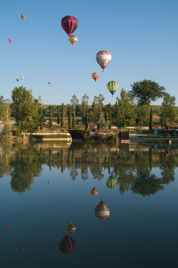 Sagrantino International Challenge Cup. Hot air balloons competition Hot Air Balloons Landscape_Collection Nature Transport Adventure Air Vehicle Balloon Basket Beauty In Nature Clear Sky Competition Cup Flying Gualdo Cattaneo Hot Air Balloon Lake Landscape Mid-air Nature Reflection Sky Sport Transportation Umbria Water