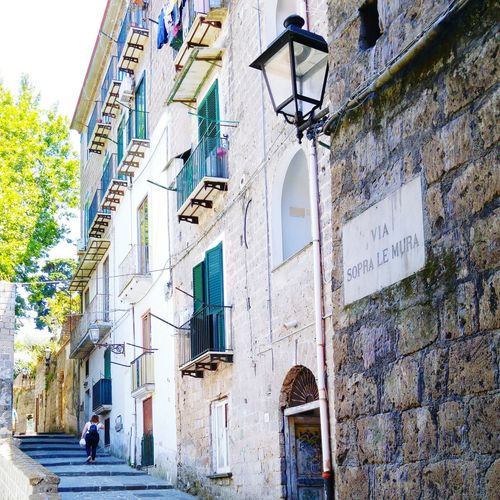Streets in Italy Architecture Building Exterior Built Structure Day Low Angle View Outdoors Place Of Worship Travel Destinations City One Person People First Eyeem Photo Architecture Stairs Street Italy