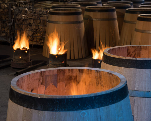 Fire - Natural Phenomenon Burning Wood - Material Factory Cooperage Roasting Roaster Roasted Barrel Wine Cask Heat - Temperature Flame No People Barrel Food Day Indoors  Close-up