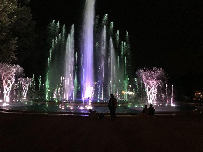 Panoramic view of illuminated fountain at night