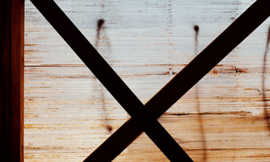 X Threeweeksgalicia No People Metal Indoors  Wood - Material Day Close-up Architecture Built Structure Pattern Cross Shape Full Frame Window Wall - Building Feature Backgrounds Textured  Shape Security Brown Rod