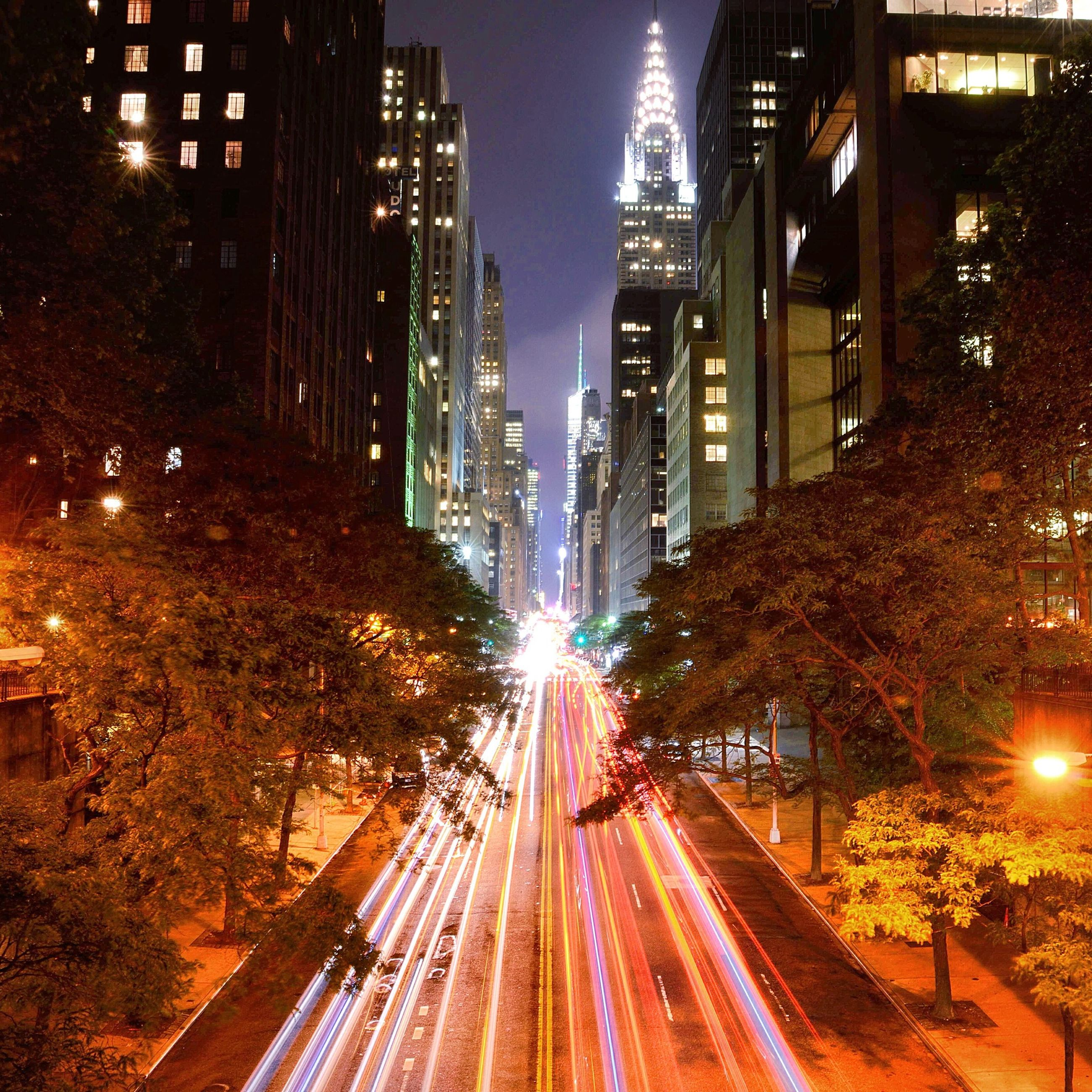 illuminated, architecture, building exterior, night, city, built structure, long exposure, light trail, transportation, motion, the way forward, speed, road, street, blurred motion, city life, city street, street light, traffic, diminishing perspective