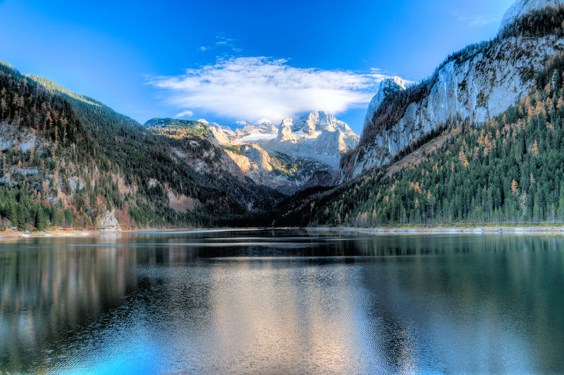 Austria Beauty In Nature Blue Day Gosausee Idyllic Lake Majestic Mountain Mountain Range Nature No People Non-urban Scene Outdoors Reflection Scenics Sky Snowcapped Mountain Tranquil Scene Tranquility Travel Tree Water Waterfront Österreich
