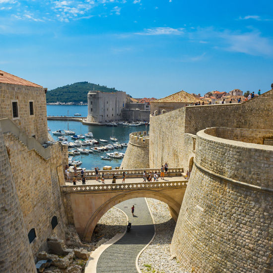 City Wall Croatia Dubrovnik, Croatia Harbor Holiday Old Town Tranquility Architecture Boat Bridge Building Exterior Built Structure City Day Dubrovnik High Angle View History Nature Outdoors Sky Summer Sunlight Travel Destinations Vessel Water