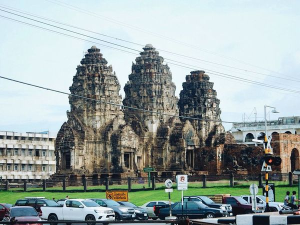 Car Architecture Built Structure Building Exterior Sky Religion Land Vehicle Transportation Cable Day Cloud - Sky Spirituality Mode Of Transport Place Of Worship Outdoors Statue Electricity Pylon Sculpture No People Lopburi Thailand