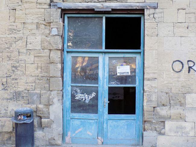Vintage Wooden Shapes Lines Glass Blue Graffiti EyeEm Selects Window Door Architecture Building Exterior Built Structure Entryway Closed Closed Door Open Door No Parking Sign Entrance Front Door Entry Door Handle Doorway Arched Wall Public Mailbox Shutter Mailbox Doorknob Locked