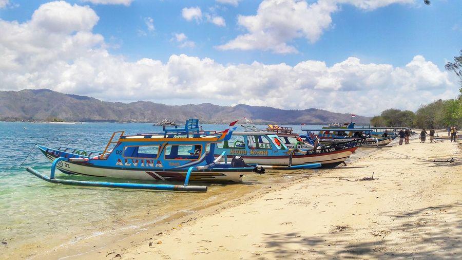 Gili Sudak Lombok Boat Lombok-Indonesia Gili Sudak Snorkeling My Best Travel Photo Genpijateng LocalGuides Island Sea EyeEmNewHere Traveller Traveling Holiday Nautical Vessel Mountain Sand Moored Longtail Boat Seascape Fishing Boat Ocean