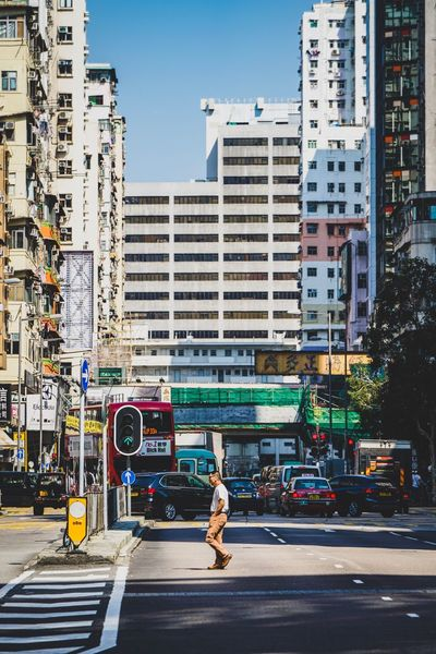 Street Photography Reframinghk Discoverhongkong Building Exterior Architecture City Built Structure Transportation Street City Life Mode Of Transportation Building Sky Motor Vehicle Land Vehicle Full Length Road Day Car City Street Crossing Residential District Incidental People