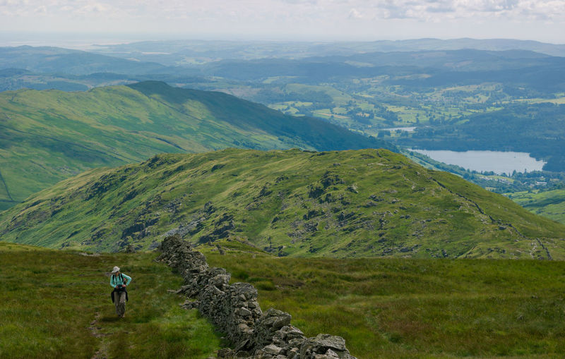 Hiking in Lake District, UK Beauty In Nature Day Healthy Lifestyle Hikingadventures Lady Lake District National Park Landscape Lifestyles Lush Mountain Range Mountains Nature Outdoors Scenics Sky View Walking Women
