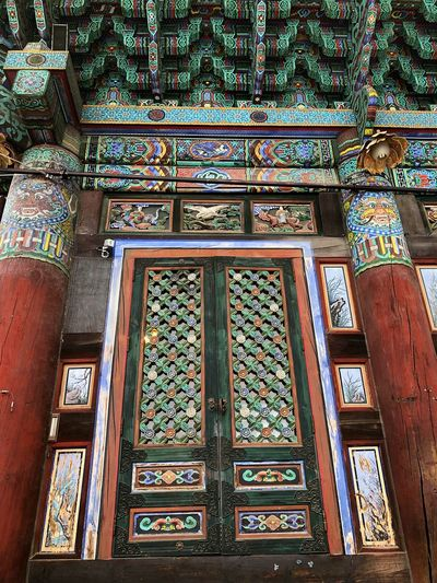 Winter Door Temple Built Structure Architecture Building Place Of Worship Belief Religion Indoors  No People Pattern Day Window Low Angle View Design Art And Craft Spirituality Creativity Glass - Material Text Ornate
