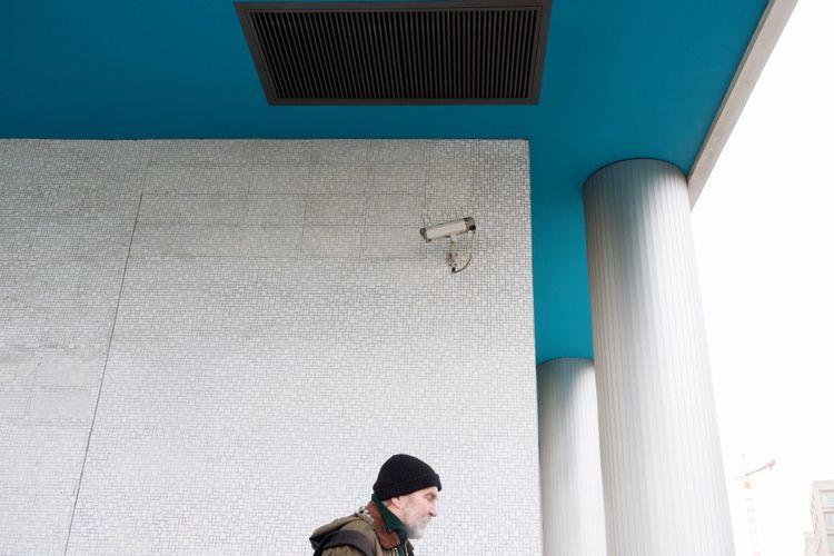 under Surveillance Cctv Communication Blue Architecture Man EyeEm Best Shots Eye4photography  Showcase March Telling Stories Differently Human Meets Technology