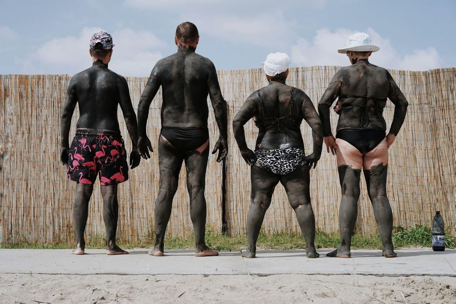 The magnificent four. Therapy Therapeutic Mud Beach Human Body Women Men In A Row Variation People Rear View Mud Muddy Mud Bath Walking Togetherness Sky Sand The Great Outdoors - 2018 EyeEm Awards The Portraitist - 2018 EyeEm Awards The Photojournalist - 2018 EyeEm Awards The Street Photographer - 2018 EyeEm Awards Be Brave