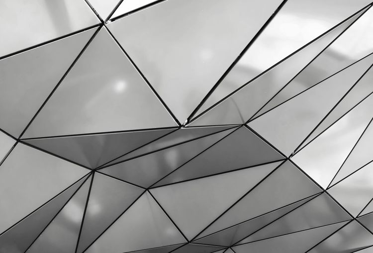 Low Angle View No People Pattern Backgrounds Full Frame Sky Geometric Shape Close-up Day Design Outdoors Architecture Built Structure Shape Metal Cloud - Sky Connection Repetition Directly Below Ceiling Structure Triangle Shape Triangle Perspective