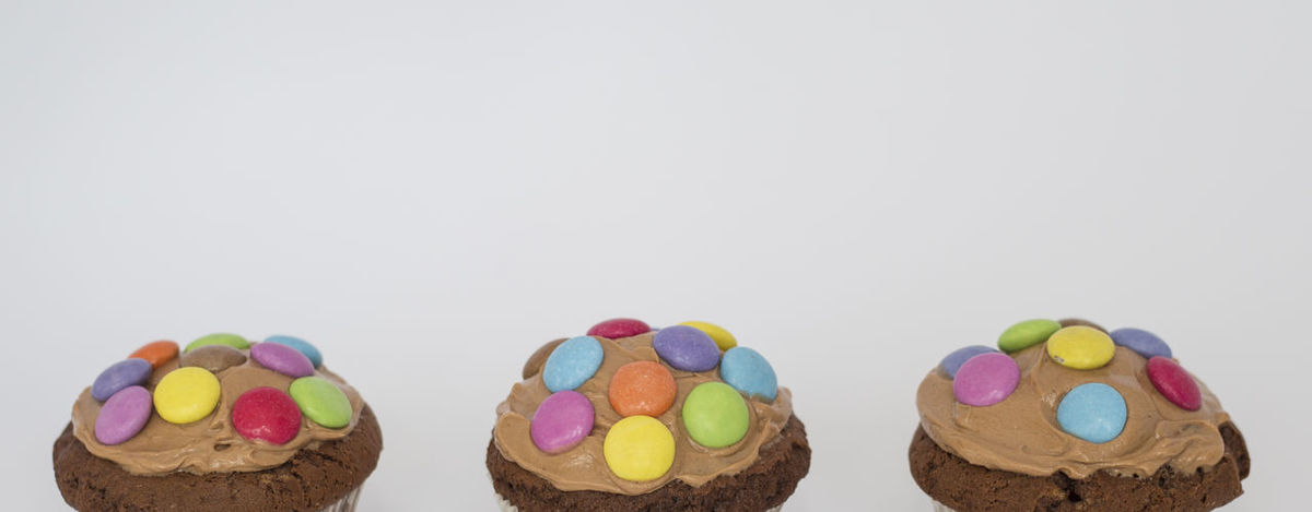 Birthday Birthday Cake Birthday Party Celebration Close-up Colorful Food Food And Drink In A Row Kids Muffins Multi Colored Studio Shot Sweet Food White Background