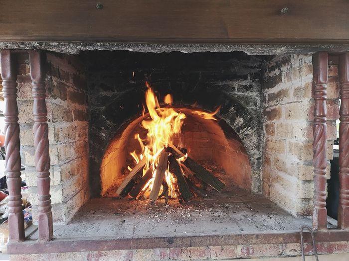Bonfire on wooden wall