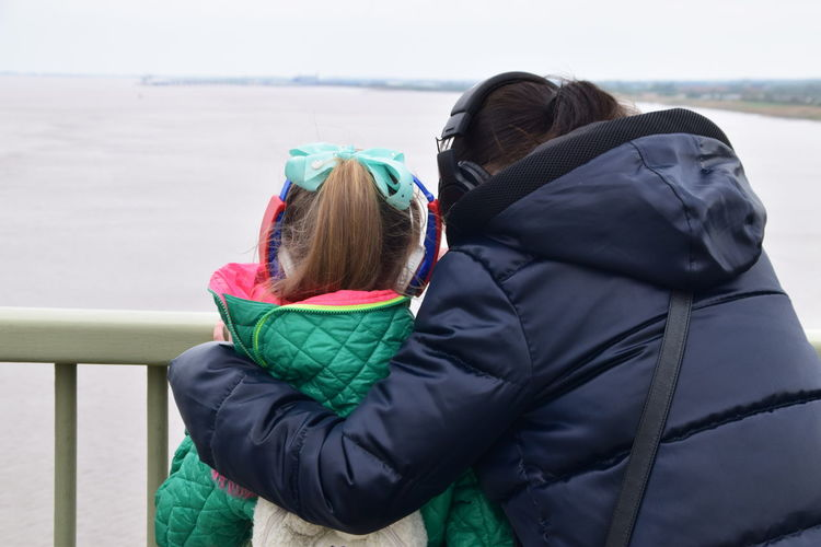 Jacket Rear View Warm Clothing Leisure Activity Outdoors People Lifestyles Day Winter Vacations Childhood Cold Temperature Adult Child Nature One Person Sky Humber Bridge Hull City Of Culture 2017 Hull2017 Hull 2017 Hull Mother And Daughter Mother And Child Looking Out