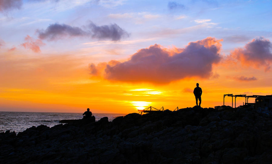 Beach Beauty In Nature Horizon Over Water Leisure Activity Nature Orange Color Outdoors Real People Rock - Object Scenics Sea Silhouette Sky Standing Sunset Tranquility Vacations Water Rethink Things EyeEm Ready   EyeEm Ready   Moving Around Rome