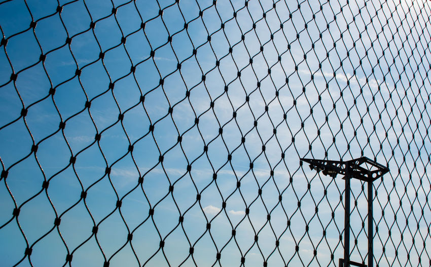 Architecture Blue Sky Blue Sky And Clouds Chainlink Fence Clear Sky Day Fence Fence Photography Fences Lightning Low Angle View Metal No People Outdoors Pattern Protection Safety Security Sky Through The Fence