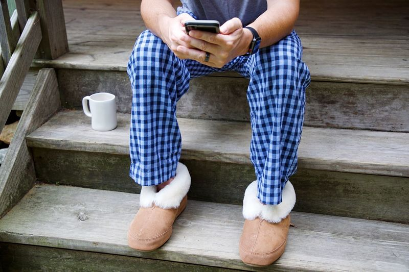 Mornings One Person Lifestyles Adult Wireless Technology Communication Sitting Technology Human Body Part Low Section Mobile Phone Staircase Human Leg Body Part Connection Leisure Activity Smart Phone Cup Men Casual Clothing Steps And Staircases