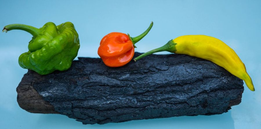 Chillis Vegetable Food And Drink Still Life Food Freshness Bell Pepper Healthy Eating Red Bell Pepper No People Studio Shot Green Color Close-up Day Charcoal Wood Charcoal Heat chilli