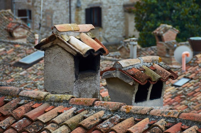 Rooftops of medieval Gubbio, Umbria Gubbio Umbria Italy Roof Rooftop Tiles Textures And Surfaces Chimney Smokestack Terracotta Urban City No People Close-up Outdoors Architecture Run Down