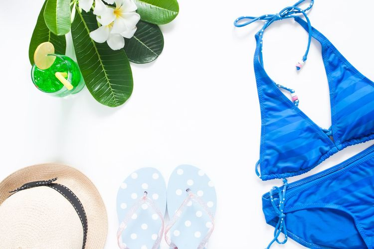 Woman's essentials in summer concept style Cocktail Holiday Lifestyle Summertime Sunlight Woman Beach Beauty Bikini Blue Day Drink Female Flip Flops Flower Leaf No People Resort Sea Sexygirl Style Summer Swimwear Vacation White Background