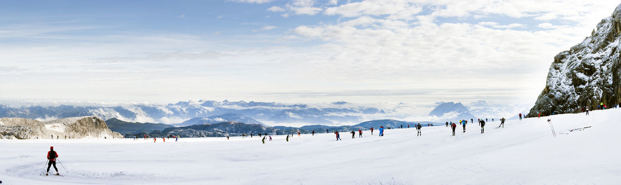 Group of people skiing on snow landscape