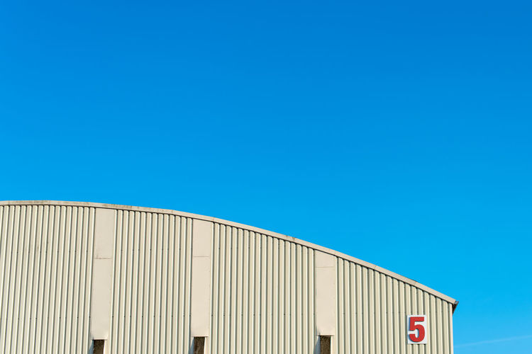 Corrugated Factory Warehouse Building Freight Transportation Metal Outdoors Industry Business Low Angle View Built Structure Sunlight Day Building Exterior Nature Copy Space Clear Sky Blue Sky No People Architecture Hoffi99 White Color