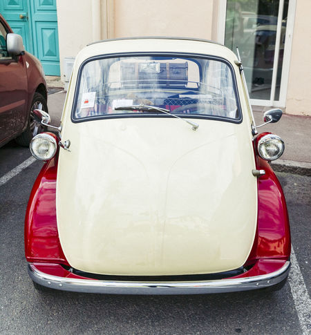 German BMW Isetta 300 with suitcase on the trunk on parking place in Saint-Tropez, France. This bubblecar was produced from 1956 – 1962. The maximum speed was 85 km/h (53 mph) and in Germany the Isetta could be driven with a motorcycle license. BMW Isetta Bavaria Cars Classic Car German Isetta Old-fashioned Retro Travel Bmw Bubble Car Bubblecar Car Collector's Car Front View Germany Microcar Mini Car Nostalgia Old Oldtimer Small Car Stationary Vintage Vintage Cars