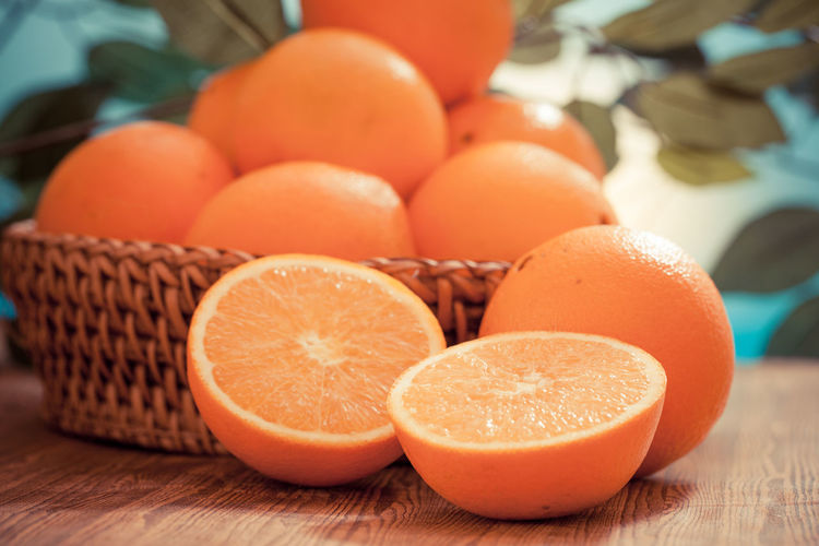 Close-up of orange fruits in basket on table