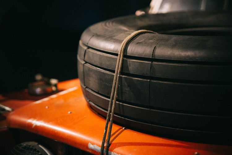 Close-Up Of Tire On Orange Surface At Workshop