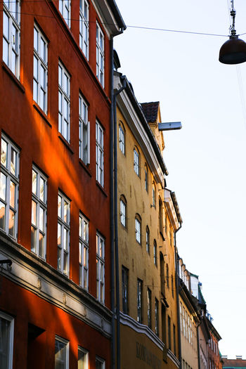beautiful house facades typical for Denmark Architecture Architecture_collection House Facade Houses Sunrays Architectural Detail Architecture Atmospheric Mood Building Exterior Built Structure Clear Sky Day Full Frame Houses And Windows Low Angle View No People Orange Color Outdoors Reflections Sky Street Light Sunshine Warm Atmosphere Window Windows
