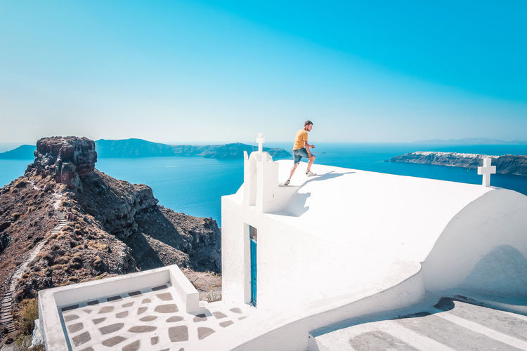Fira Santorini Santorini, Greece EyeEm Selects Only Men One Man Only Adults Only Sea One Person Adult People Outdoors Leisure Activity Clear Sky Sunlight Full Length Sport Day Standing Men Beach Blue Sky Skill