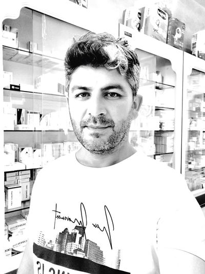Portrait of young man standing in store