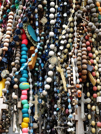 Low Angle View Of Rosary Beads Hanging For Sale At Market