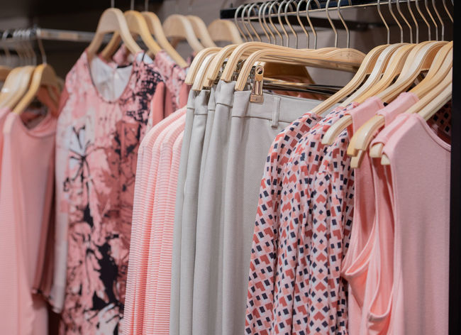 Summer fashion on a clothes rack Boutique Colors Department Store Fashion Sale Textiles Women's Outfitters Accessories Clothes Rack Clothing Outerwear Shelving Shirt Shop Summer Fashion Summer Sale Women Women's Clothing Women's Fashion