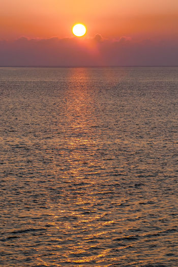 Sunset Sky Beauty In Nature Sea Water Scenics - Nature Horizon Over Water Horizon Tranquil Scene Sun Tranquility Orange Color Waterfront Idyllic No People Nature Rippled Cloud - Sky Sunlight Outdoors Romantic Sky