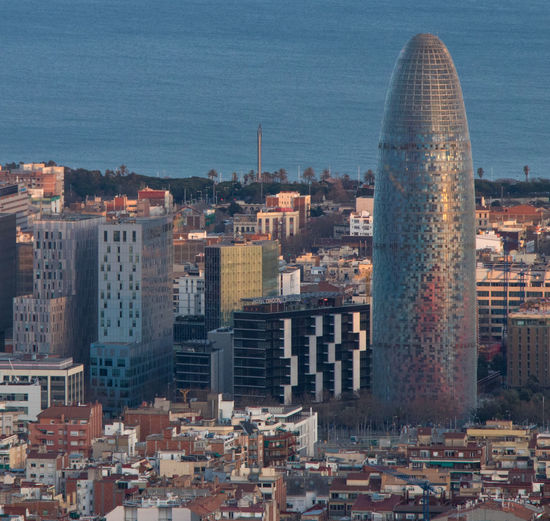 Barcelona Mediterranean  Torre Agbar Agbar Architecture Building Exterior Built Structure City Cityscape Day High Angle View Jean Nouvel Mar No People Outdoors Sea Sky Skyscraper Urban Skyline