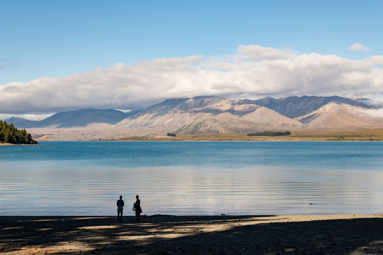 Walking in beauty Water Mountain Sky Two People Scenics - Nature Real People Beauty In Nature Cloud - Sky Tranquil Scene Nature Men Mountain Range Standing Tranquility Togetherness Lake Day Non-urban Scene Lifestyles Outdoors Couple - Relationship New Zealand Scenery
